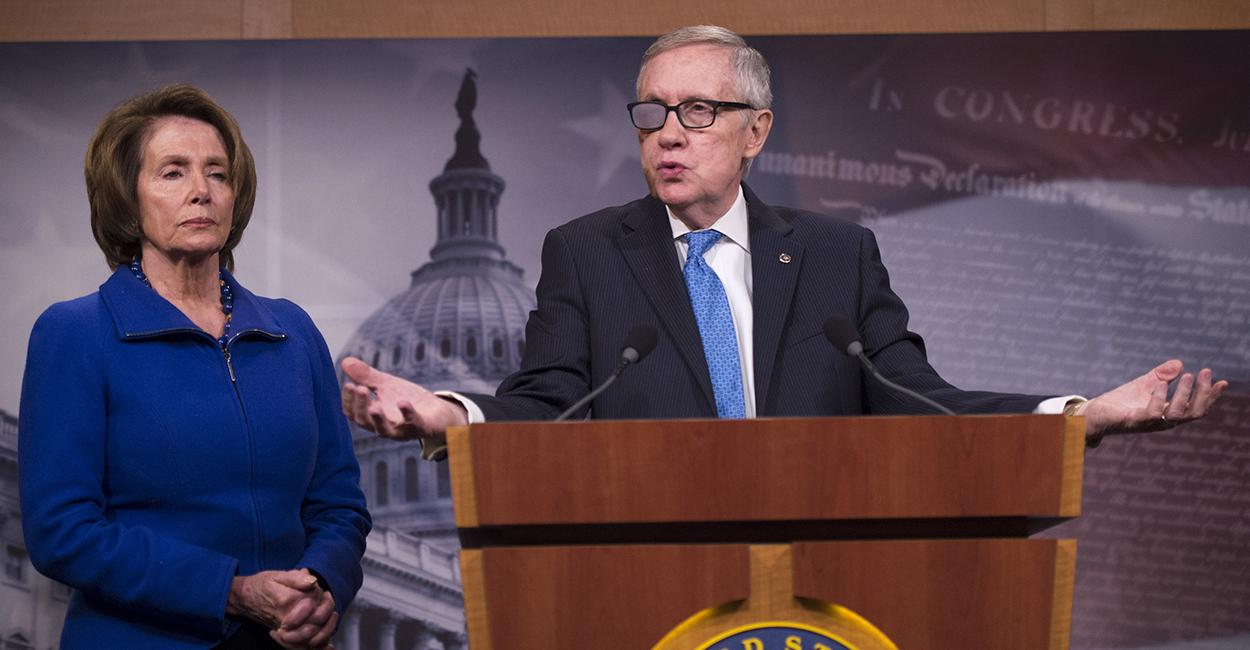 Senate Majority Leader Harry Reid and House Minority Leader Nancy Pelosi speak on the DHS funding debate Feb. 26. (Photo: Kevin Dietsch/UPI/Newscom)