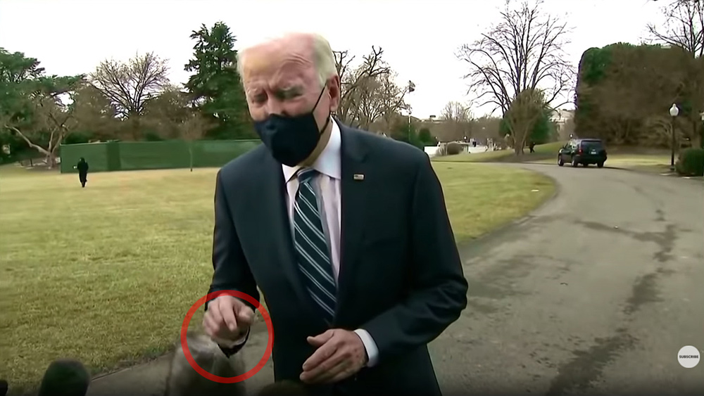 Image: FAKE CGI Biden caught moving hand through reporter's camera gear even though his image was standing several feet away