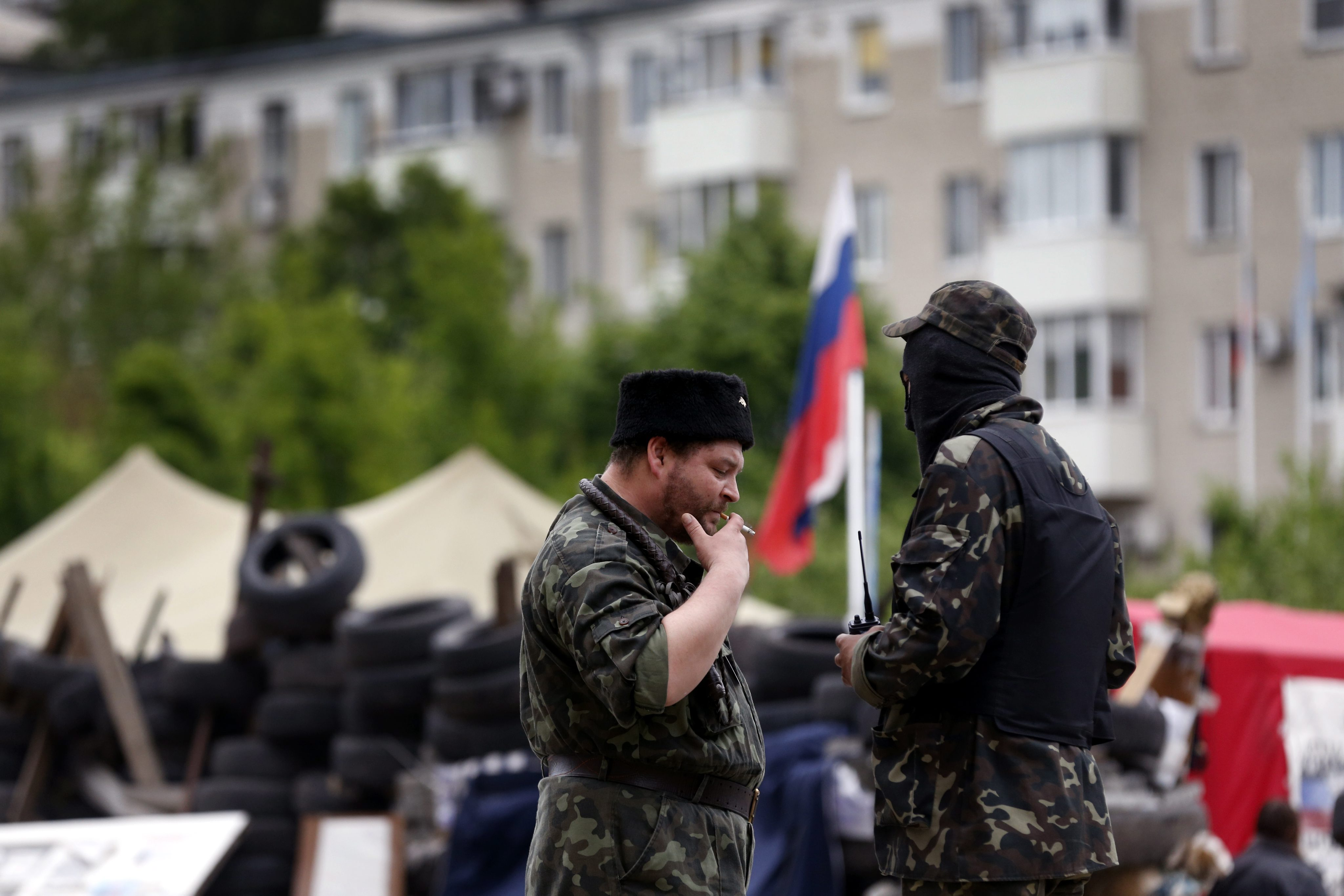 Supporters of the self-declared Donetsk People's Republic stand in front of the occupied regional administration building in Donetsk, Ukraine, May 12, 2014. (Photo: Maxim Shipenkov/Newscom)