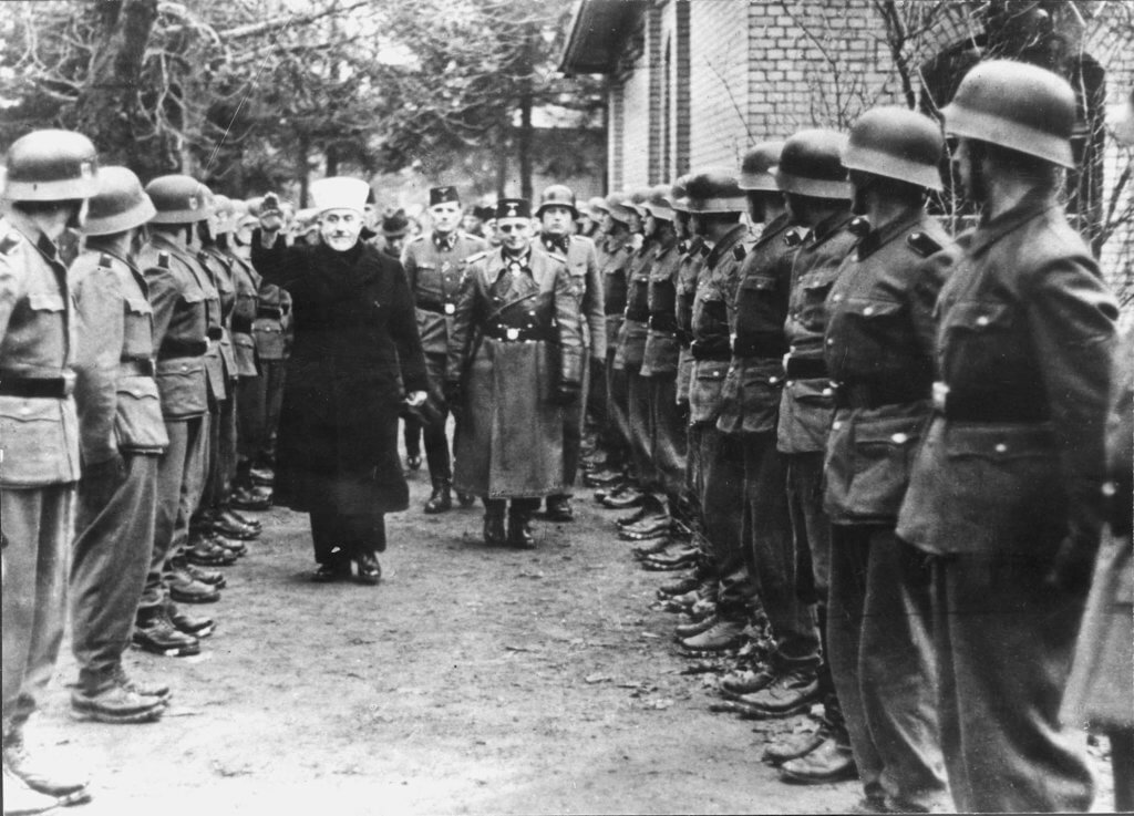 Haj Amin al-Husseini reviewing a unit of Muslim Bosnians in the service of the Nazis (Yad Vashem photo archives)