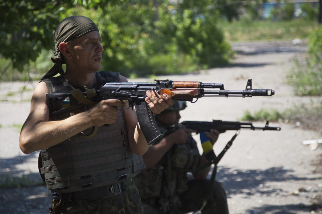 Ukrainian servicemen patrol in the town of Marinka, near Donetsk, Ukraine. (Photo: Alex Rom/EPA/Newscom)
