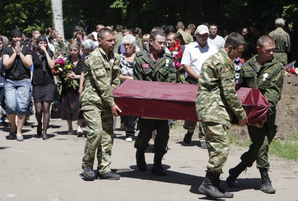 Pro-Russian rebels carry a coffin with the body of their comrade who was killed June 6 during fighting in the town of Marinka, in Donetsk, Ukraine. (Photo: Alexander Ermochenko/EPA/Newscom)