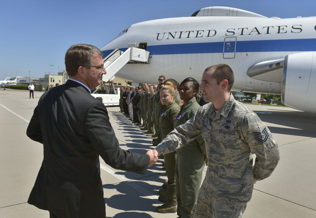 Secretary of Defense Ash Carter offers a coin and a handshake to a line of air crew personnel as he prepares to board an E4-B aircraft in Stuttgart, Germany on June 5. (Photo: Department of Defense/Sipa USA/Newscom)