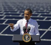 President Barack Obama and solar panels
