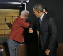 President Barack Obama rubs elbows with actor Steve Martin