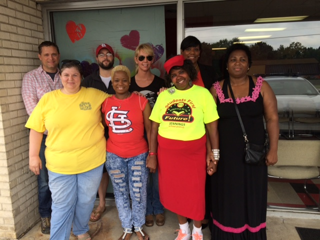 Volunteers with the St. Louis Tea Party Coalition gather with Dellena Jones outside her shop, 911 Hair Salon. The St. Louis Tea Party Coalition has been helping Jones rebuild after protests erupted in Ferguson, Mo., last year and again on Sunday. (Photo: Dottie McKenna Bailey)