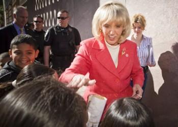 Arizona Gov. Jan Brewer greets elementary school students