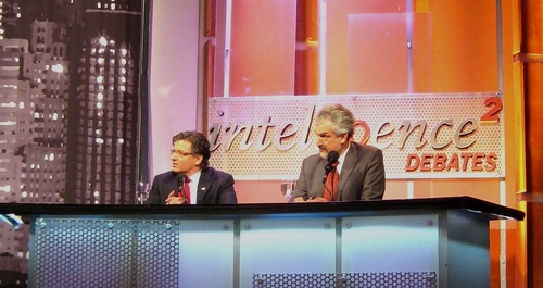 Zuhdi Jasser (L) with the author as teammates at a 2012 Intelligence Squared debate in New York City.
