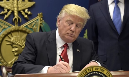Donald Trump signing an executive order at the Pentagon on Jan. 27, 2017.