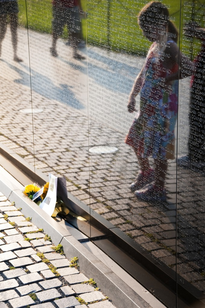 A child's silhouette is reflected in the surface of the Vietnam Wall. (Photo: Getty Images)