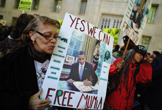 Protestors at a rally for convicted cop-killer Mumia Abu-Jamal. (Credit: MANDEL NGAN/AFP/Getty Images/Newscom)