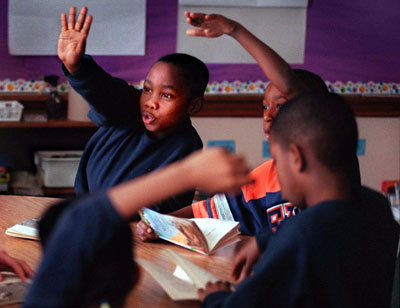 Students at Milwaukee's private Urban Day School compete for the teacher's attention