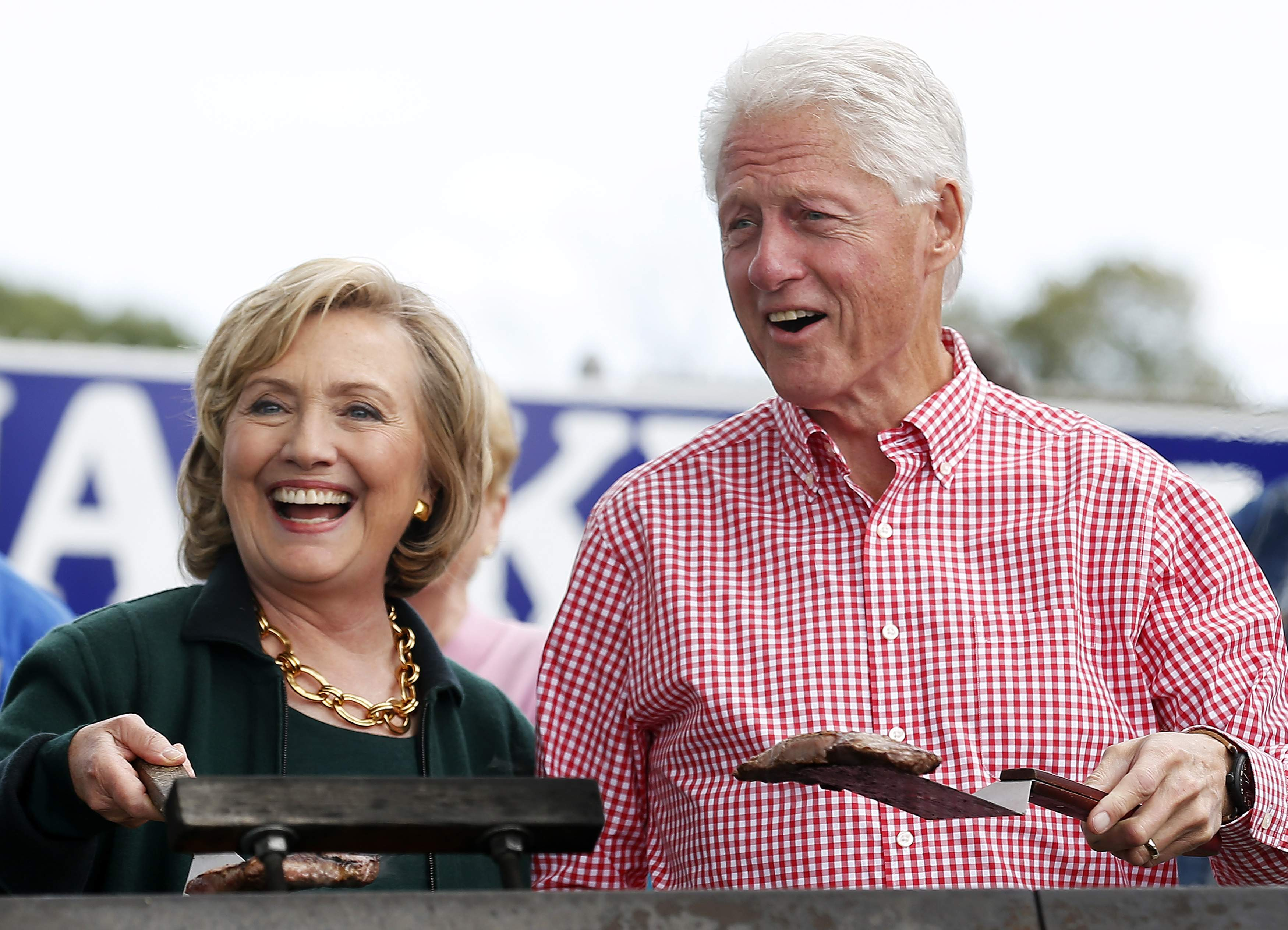 Clinton and her husband hold up some steaks at the 37th Harkin Steak Fry in Indianola, Iowa. (Photo: Jim Young/Reuters/Newscom)