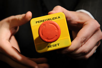 An assistant shows the block with a red button marked reset in English and overload in Russian that US Secretary of State Hillary Clinton handed to Russian Foreign Minister Sergei Lavrov during a meeting on March 6, 2009 in Geneva.