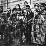 Children behind a barbed wire fence at the Nazi concentration camp at Auschwitz in Southern Poland.   (Getty Images)