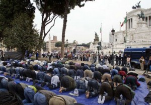 Muslim immigrants in Rome illegally take over the Piazza Venezia in Rome, Italy.