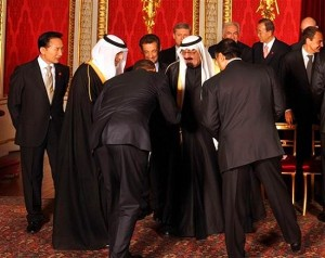 """A deep bow from the waist is a recognized sign of submission to the person you are bowing to, in much the same way that a dog will lay down before it's master. The meaning of the word """"Islam"""" is 'submission'. That is what you are watching in this photo - Obama, as the leader of America, submitting to a foreign, Muslim king. You will note that the King is not bowing in return, but instead maintains the superior position."""