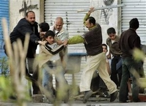 Egyptian Christian being beaten by Muslims
