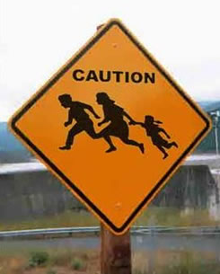 caution-illegal immigration sign