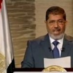 Morsi speaks during his first televised address to the nation