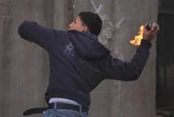 Arab youth throws firebomb