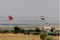 Turkish and Syrian flags are seen on the Turkish-Syrian border