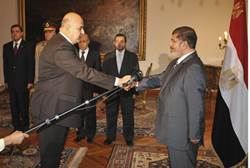 Morsi and new Vice President Judge Mahmoud Mekki