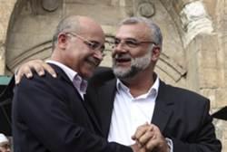 MK A-Sana (left) with Sheikh Kamal Rian