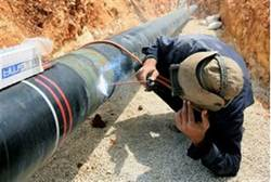 Mekorot worker fixes pipe