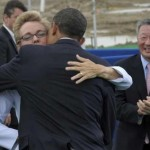 President Barack Obama gives Gov. Jennifer Granholm a hug as LG Chem Ltd. Chairman Bon-Moo Koo, left, watches (AP)