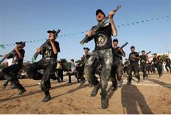 Hamas campers ages 12 - 18 perform mock exercises