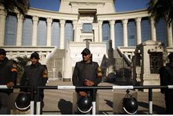 Policemen stand guard outside the constitutional court in Cairo