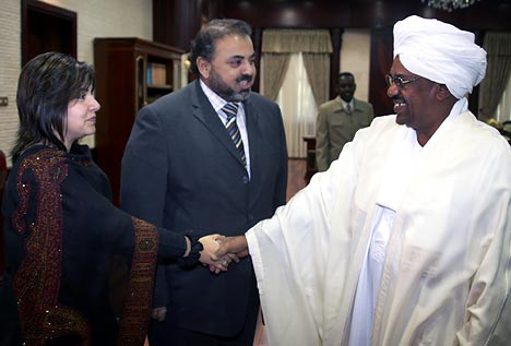 Lord Ahmed and axis ally Baroness Warsi meeting international war criminal President Bashir of Sudan