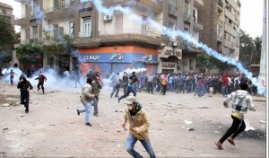 Egyptians Running From Gas Canisters