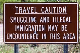 travel caution sign-illegal immigration