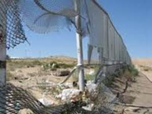 broken border fence