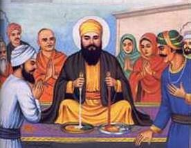 Nanak sqeezing milk from Lalo's bread, and blood from that of Malik Bhago