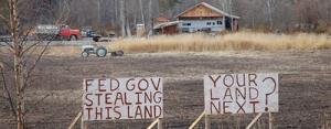 Obama_stealing_land