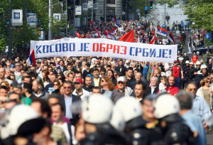 Protesters hold banners against the the EU-brokered Kosovo accord and call for a referendum on the deal as they march in Belgrade April 22, 2013