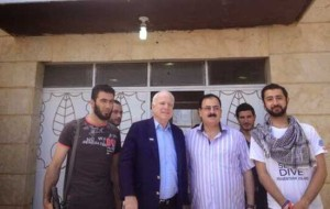 McCain posed for pictures with these ISIS rebels, smiling as the camera snapped. Now, ISIS, Islamic State of Iraq and Syria formerly known as Al Qaeda in Iraq, is using those pictures as a campaign ad.