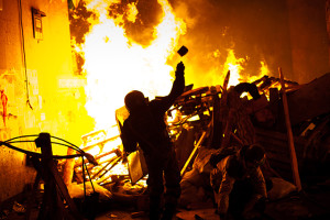 Anti-government protesters clash with the police during their storm of the Independence Square in Kiev on February 18, 2014. Flames engulfed the main anti-government protest camp on Independence Square on Tuesday as riot police tried to force demonstrators out following the bloodiest clashes in three months of protests. The iconic square turned into a war zone as riot police moved slowly through opposition barricades from several directions, hurling stun grenades and using water cannon to clear protestors. Photo by Emeric Fohlen/NurPhoto/Sipa USA (Newscom TagID: sipaphotosfour599319.jpg) [Photo via Newscom]