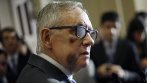 Reid wears therapeutic glasses during a news conference after the weekly Senate Democratic policy luncheon at the U.S. Capitol in Washington