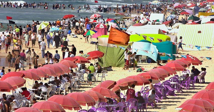 Palestinians crowd the Mediteranean beach of Gaza City on the traditional Muslim day