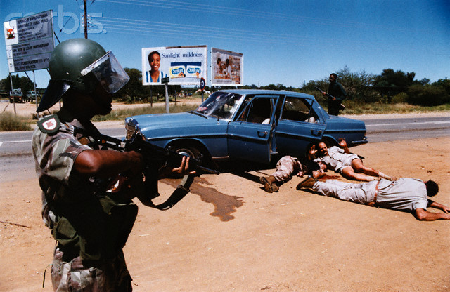March 11-12, 1994, Bophuthatswana, South Africa --- White supremacist Afrikaner Weerstandsbeweging (AWB) invading the territory of Bophuthatswana to try to restore the apartheid status quo. Three wounded members of AWB following a shootout with Bophuthatswana Defence Force were shot dead by outraged BOP soldier O.B. Menyatsoe. --- Image by © Megan Patricia Carter Trust/Sygma/Corbis