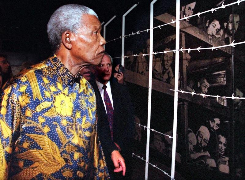 Former South African President Nelson Mandela views a large photo mural of Jewish concentration camp inmates in the Buchenwald camp during World War II as he tours the Yad Vashem Holocaust Museum October 18. Later Mandela laid a wreath in memory to the six-million Jews who perished at the hands of the Nazis during the holocaust. of World War II. JWH/WS - RTRRL09