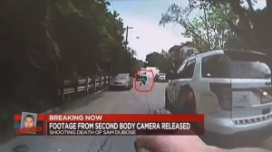 Second video  from an arriving officer  shows OfficerTensing lying in the road.
