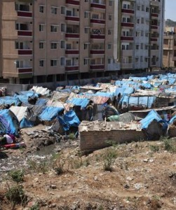 3rd World Refugee Tents Next to Apartment Blocks