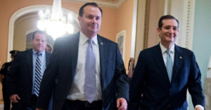 UNITED STATES - OCTOBER 16: Sens. Mike Lee, R-Utah, left, and Ted Cruz, R-Texas, make their way to the Senate floor in the Capitol where the Senate voted to end the government shutdown and raise the nation's debt ceiling. (Photo By Tom Williams/CQ Roll Call)