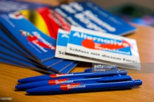The Alternative for Germany (AfD) logo sits on pens as election campaign leaflets sit on display inside the party's campaign office in Magdeburg, Saxony-Anhalt state, Germany, on Monday, Feb. 29, 2016. While Chancellor Angela Merkel's Christian Democratic Union (CDU) has a chance to win the contests in Baden-Wuerttemberg, Rhineland-Palatinate and Saxony-Anhalt, a strong showing by the anti-immigrant Alternative for Germany party would risk increasing opposition to her open-door policy within her party. Photographer: Krisztian Bocsi/Bloomberg