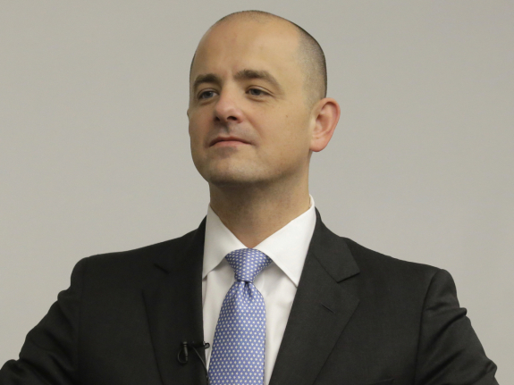 In this Aug. 27, 2016 photo, Evan McMullin, an independent presidential candidate, adjusts his jacket during a staff meeting near Salt Lake City. McMullin, a Brigham Young University graduate, former CIA officer, investment banker and congressional aide, is running as a third-party conservative. (AP Photo/Rick Bowmer)